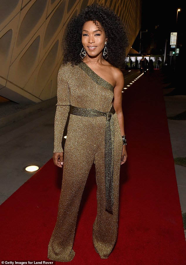 How does she do it? Black Panther actress Angela Bassett, 60, looked ageless in her shimmering gold off the shoulder suit