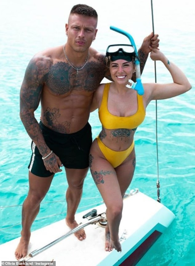 Happy together: Olivia slipped into a yellow bikini when she went swimming with turtles as she branded her husband her 'favourite' person