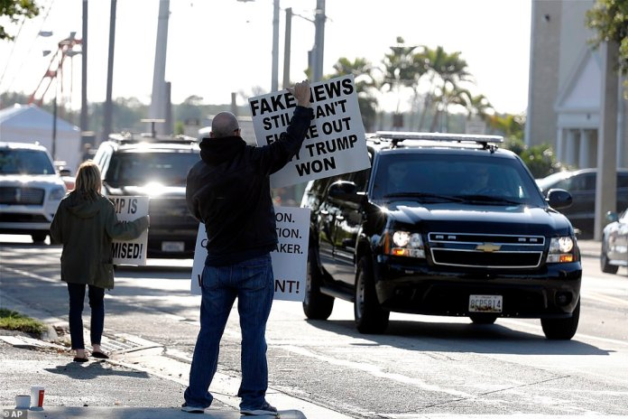 The fans of Trump greet his racers on Saturday as she travels from Mar-a-Lago to the Trump International Golf Course