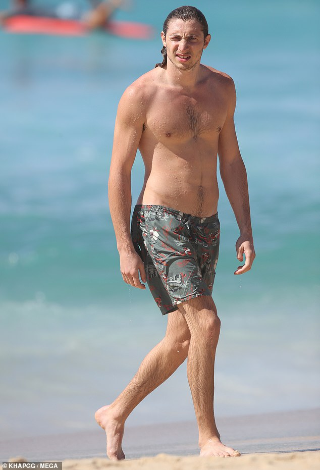 Attire: Ben, who is a friend of Sailor's brother Jack Brinkley-Cook, wore green patterned boardshorts on the beach outing