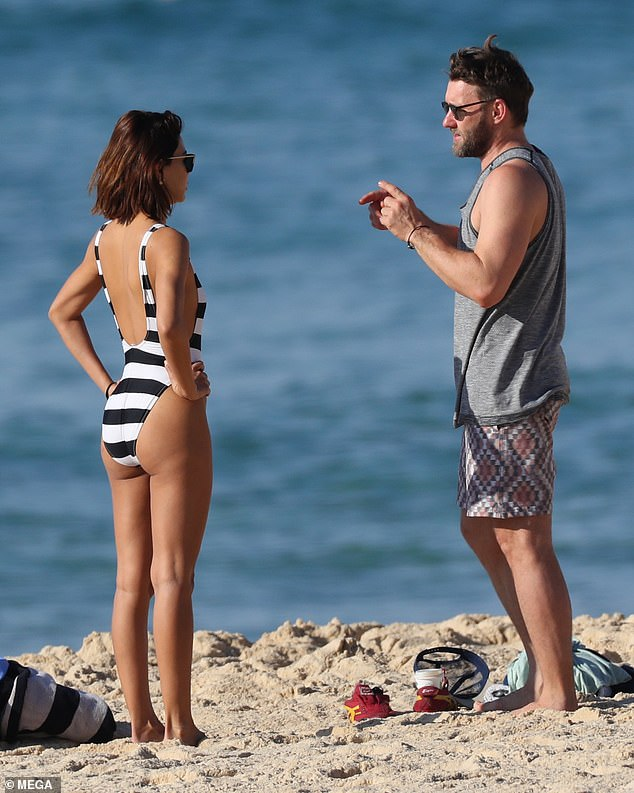 Just the two of us! The smitten duo were seen chatting on the sand as they dressed together