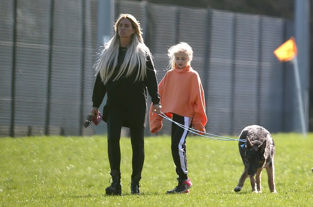 Sun Walk: Katie Price, 40, came out to see her boyfriend Kris Boyson in action during a Sunday soccer game in Kent and was accompanied by her daughter Princess, 11