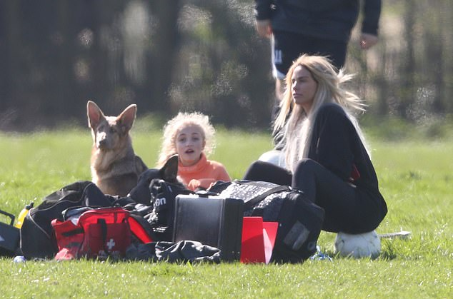 Relaxing: Katie and Princess sat between health and safety supplies during the game