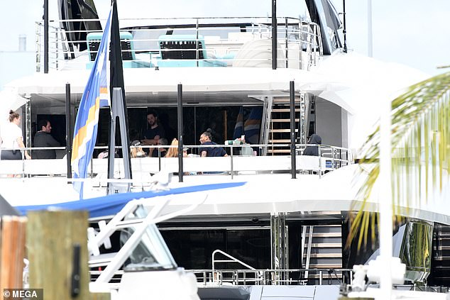 Chill time:The couple were joined by a collection of friends as they hung out and chatted on the balcony section of the superyacht