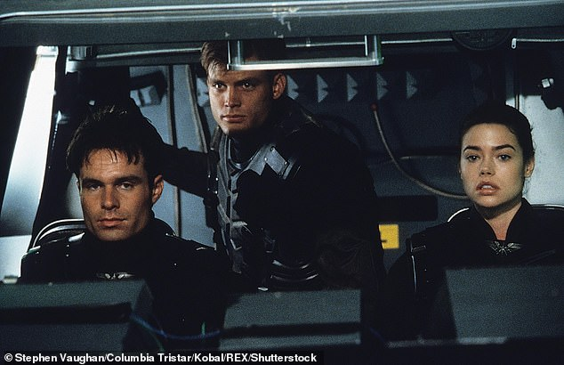 Sci-fi satire: Patrick and Denise are shown in a still from the 1997 sci-fi satire Starship Troopers along with Casper Van Dien