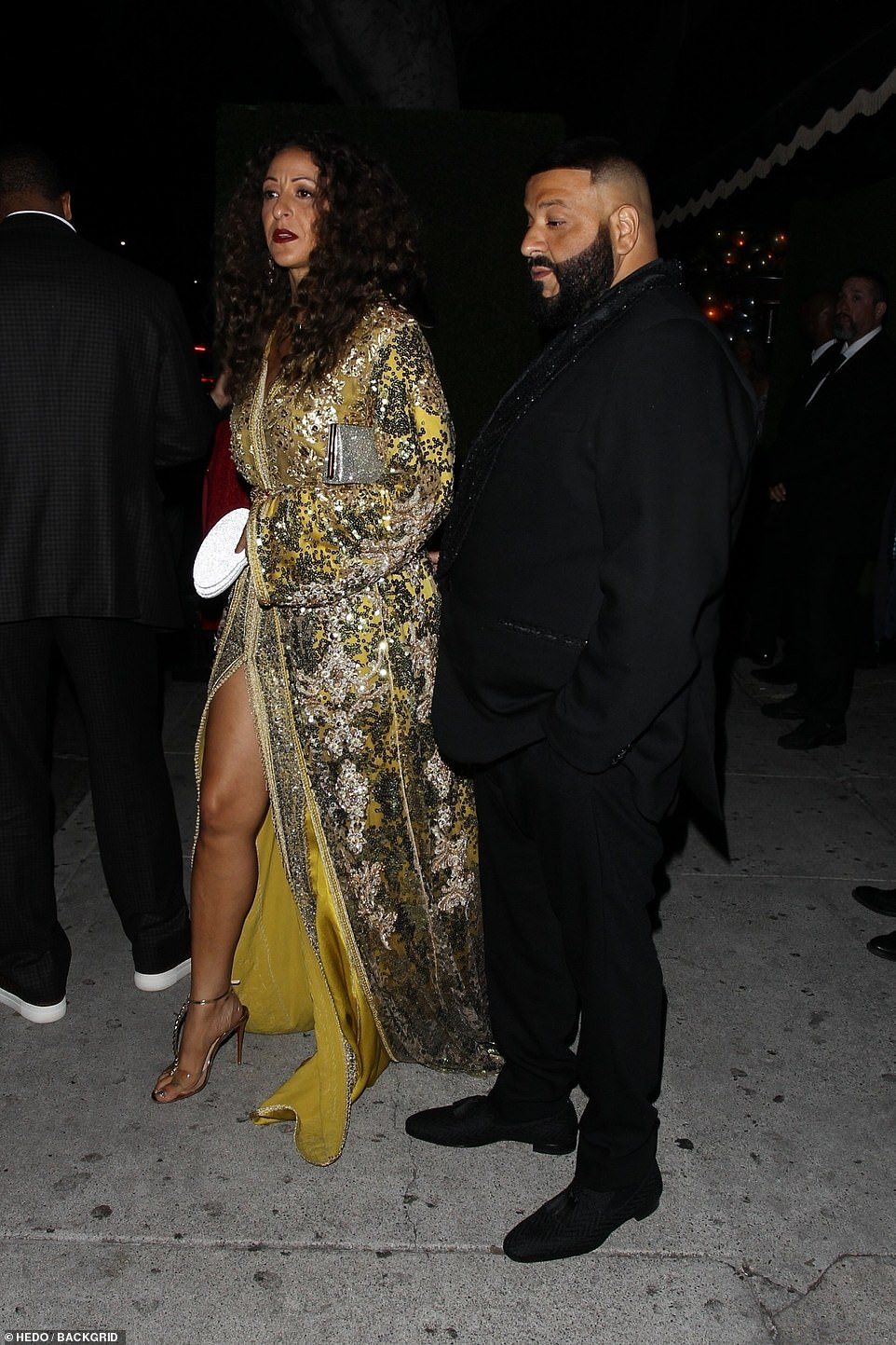 Good looking couple: Musician DJ Khaled joined by his gorgeous wife Nicole Tuck, who wowed in a gold gown