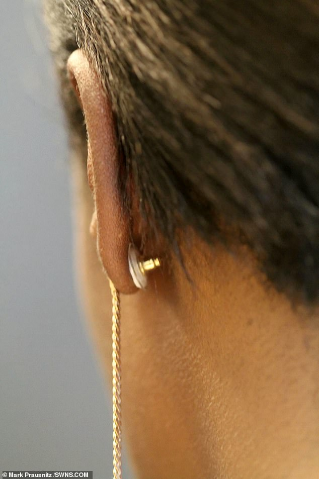 The adhesive patch on the back of the earring (pictured, a prototype of the patch) would contain hormones which, when put onto the skin, pass into the bloodstream and prevent pregnancy