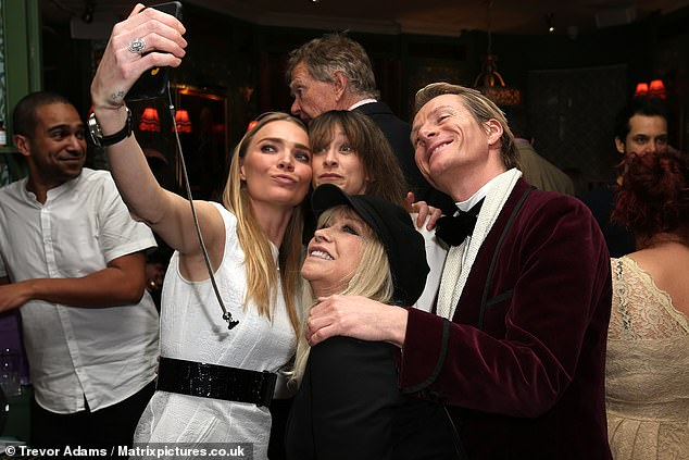 All together now: Ronnie Wood's former wife posed for a selfie with daughter Leah Wood and Jodie as the night wore on