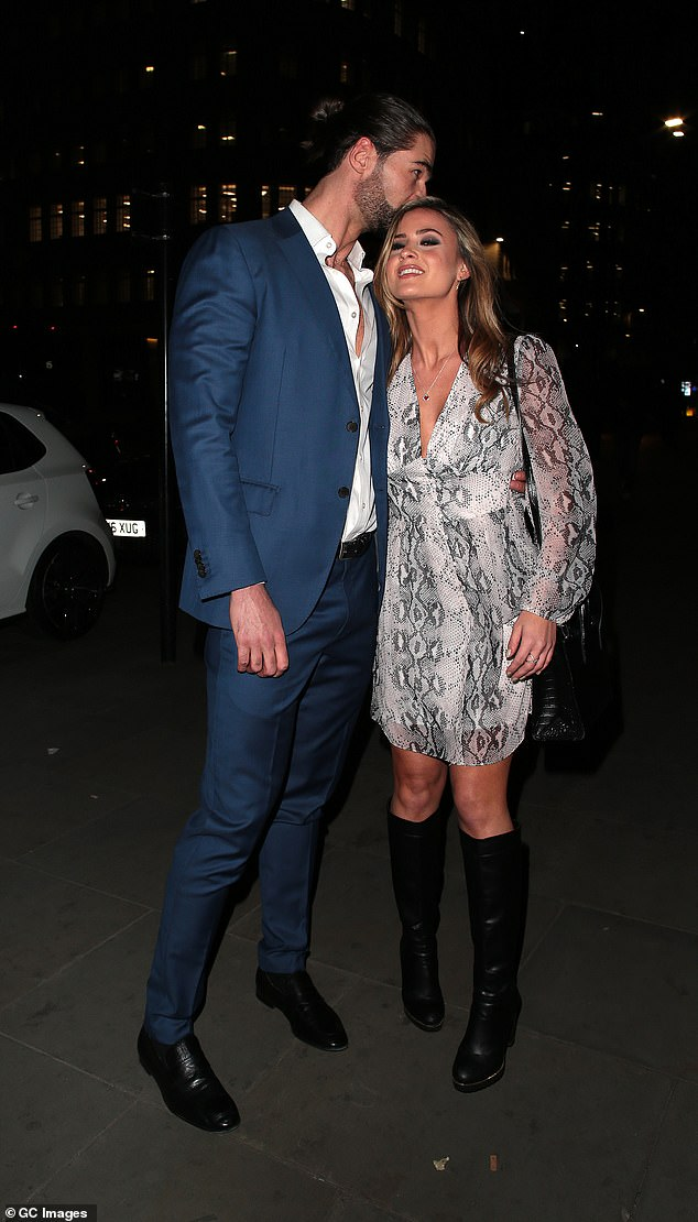 Besotted: The pair's smitten display continued as they exited the event, with the personal trainer lavishing the beauty with kisses as they strolled along