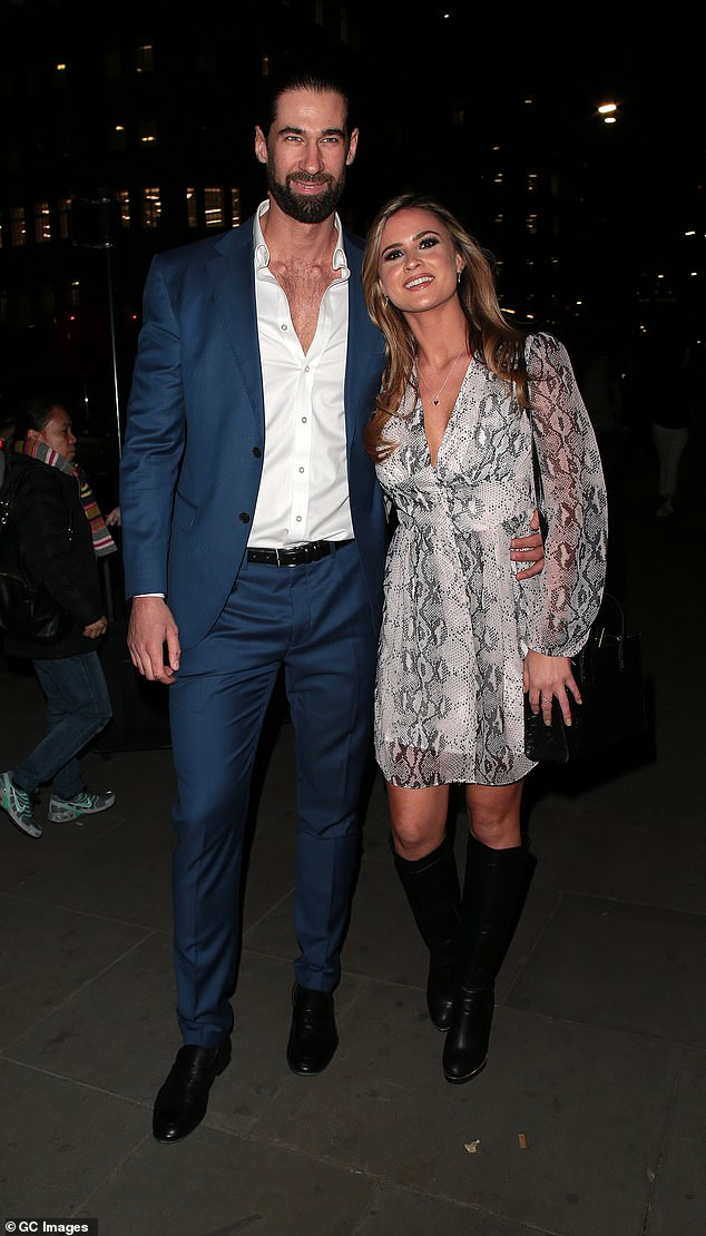 Pretty: Alicia clad her sensational figure in a flirty snakeskin print dress which plunged down the middle to showcase her ample cleavage