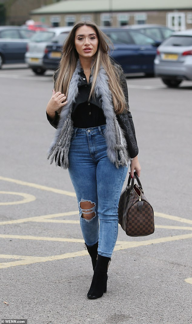Dressed up: She accessorised her look with black suede high-heeled boots, and sported barely-there makeup