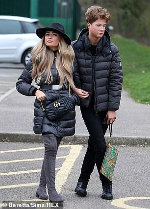 Casual: Joey cut a casual figure in a coat to match his friend Ella