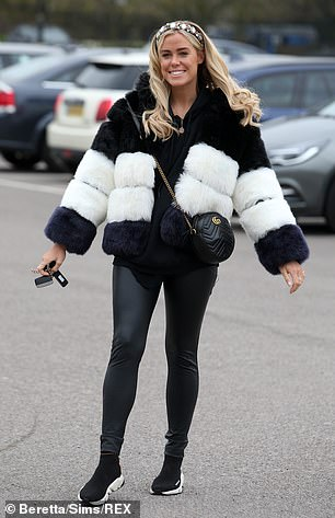 Black and white: Meanwhile Chloe Meadows donned a monochrome fur jacket