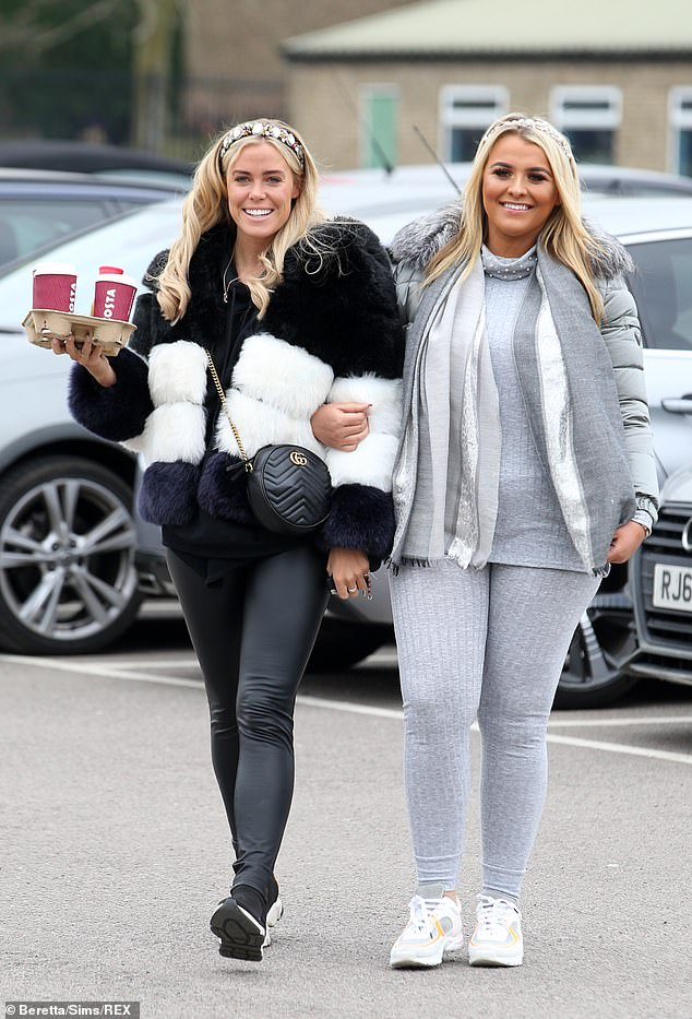 Well-prepared: Chloe ensured she andSaffron Lempriere (right) had coffee for the occasion as they headed into the stadium