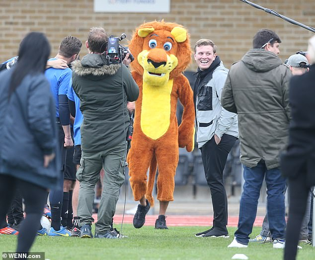 Who is that? The boys seemed utterly bewildered as they spotted the mascot arriving, with the camera crew filming every moment