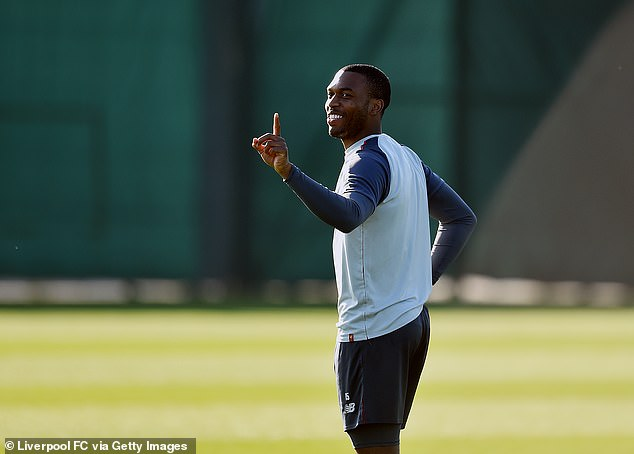 Striker Daniel Sturridge wags his finger during a sunny training session at Melwood on Friday