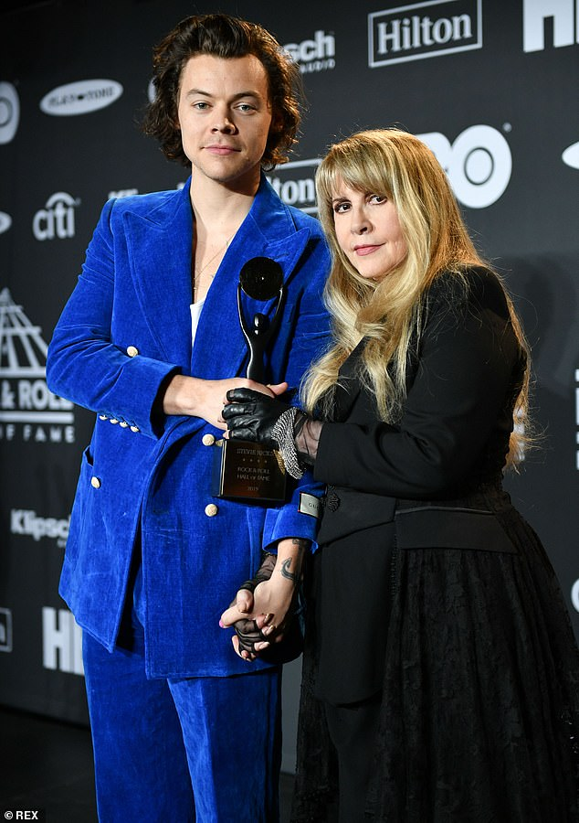 Different generations: Harry was unmissable in a royal blue crushed velvet suit; pictured with Stevie Nicks