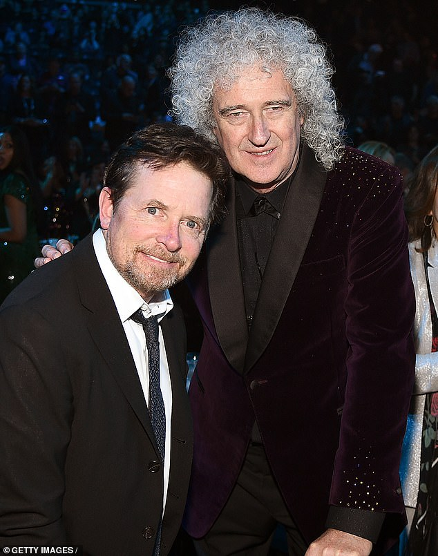 Rubbing elbows: Queen's Brian May stopped to chat with Michael J. Fox during the ceremony