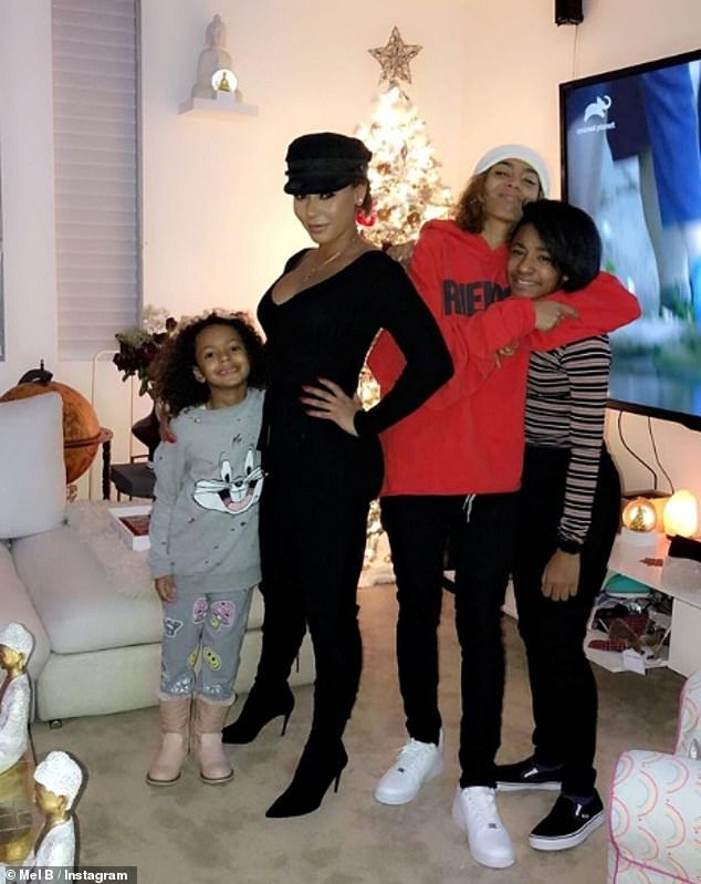 Happy family:Mel is the mother of three daughters - Madison with Stephen Belafonte, Angel, 11, with Eddie Murphy, and Phoenix, 20, with Jimmy Gulzar