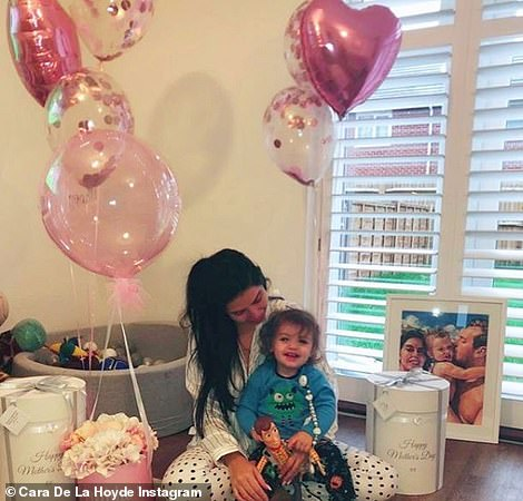Lucky lady: Cara was spoiled with bouquets of everlasting roses and a pink balloon