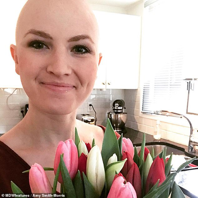 Amy Smith-Morris, a pharmacist who helps treat cancer patients, said she believes a positive mindset is key to fighting the disease (Pictured: After her chemotherapy in early 2017)