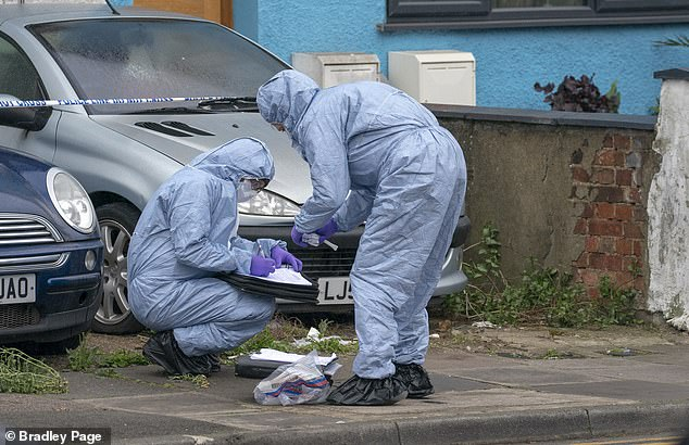 Kakaire knifed four men and a woman in a horrific spree of violence in Edmonton, north London. Pictured: Police at the scene of the fifth stabbing, in Aberdeen Road, Edmonton, in April last year