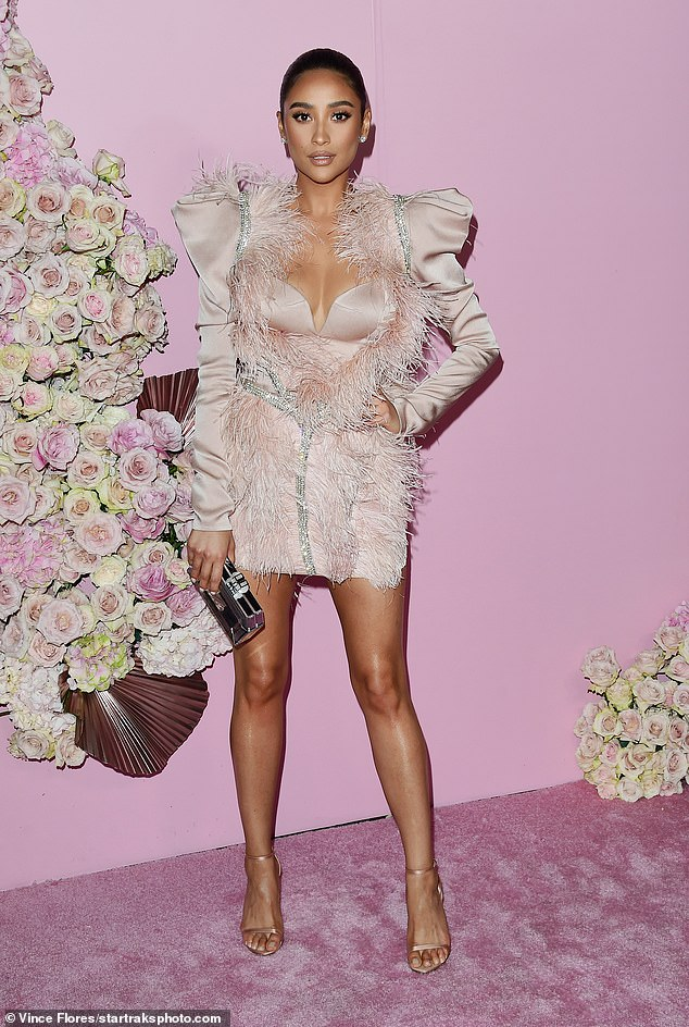 All pink everywhere: Shay Mitchell wore an extravagant pink feathered mini dress with a plunging neckline to attend the Patrick Ta beauty launch party event in LA on Thursday
