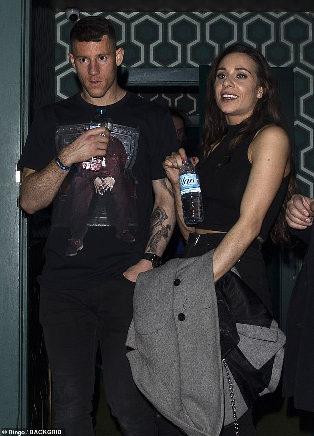 Night: Ross was pictured making his way out of the venue around 5am with a female friend