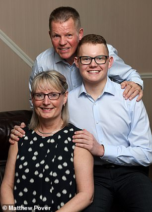 The decision to have the surgery while awake lay with the young patient and his parents, Richard, 56, a crew manager for Lancashire Fire and Rescue Service and Jackie, 55, who recently retired from her job at Tesco (pictured together)