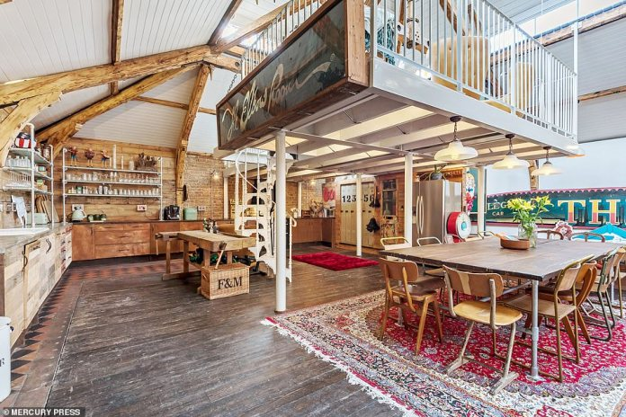 The trendy meets traditional house has three bedrooms, a family bathroom, kitchen and dining room (picture), study areas and a mezzanine overlooking the reception area