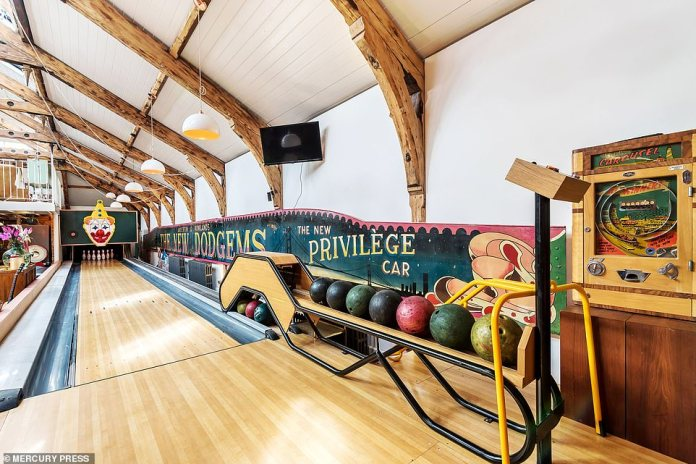The remodeled school bath from the 19th century in St Leonards, East Sussex, which is now a luxurious family home with a bowling alley (pictured)