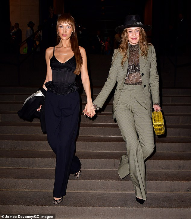 Twinning:IMG Model sisters Bella (L) and Gigi (R) Hadid turned up, hand-in-hand, to the ceremony rocking black and green pantsuits