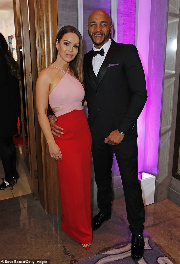 True love: Katie Piper looked incredible in a colour block dress as she cosied up to her husband Richard Sutton at Global Gift Galaat Corinthia London on Monday