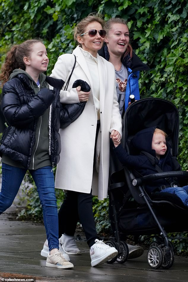 Family Day: Geri couldn't be happier as he walked with his family
