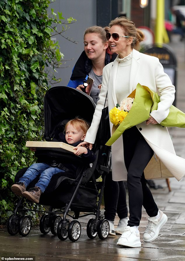 A beautiful look: Geri showed a radiant smile while enjoying the day with his family