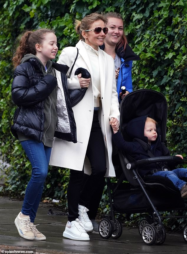 Race: Bluebell - whose father is screenwriter Sacha Gervasi - looked lovely in a quilted jacket, green sweatshirt and jeans, while Monty - whom Geri shares with her husband Christian Horner - was cute with sweatshirt and jeans
