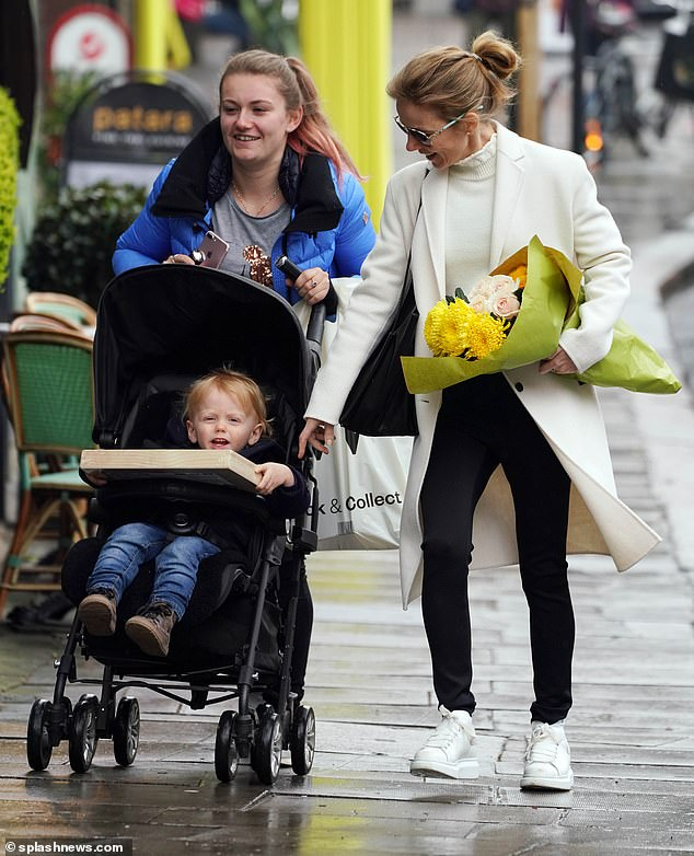 Watch me! Geri shared a joke with his son while the couple walked