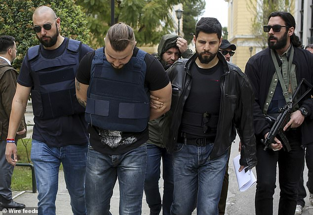 Bulgarian man Yuliyanov J Raychev Serafim (centre, left), 31, is one of the brothers who allegedly stalked and gunned down Macris at his home in Greece