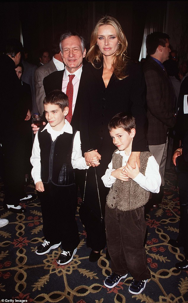 Hugh Hefner, wife Kimberly and sons Cooper and Marston are pictured April 1998