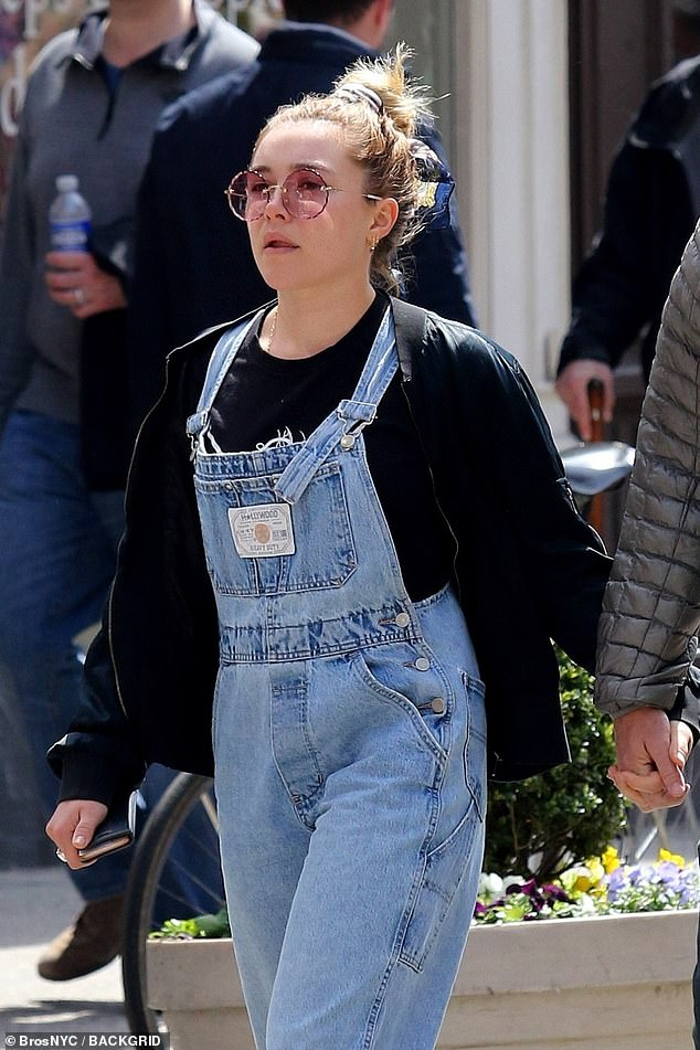 The look: When she was seen out with Zach on Friday, Florence wore a set of denim overalls with a black sweater and a large pair of pink sunglasses