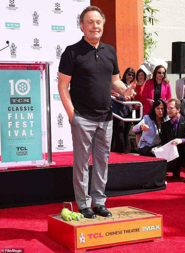 What a day:Billy Crystal joined an exalted rank of stardom Friday when he got his hand- and footprints placed outside the TCL Chinese Theatre in Hollywood