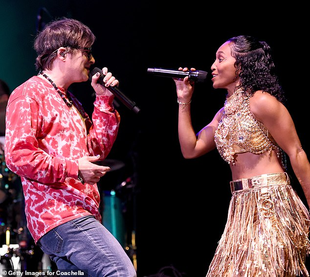 All stars: And the core quartet of Rivers Cuomo, Patrick Wilson, Brian Bell and Scott Shriner, has been designed by special guests such as Rozonda & # 39; Chilli & # 39; Thomas accompanies [pictured, right]