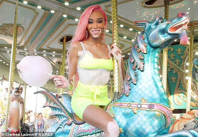 Fun times: Winnie Harlow, 24, showed just how much fun she was having as she larked about on a carousel at the Revolve Festival at Merv Griffin Estate in California on Saturday