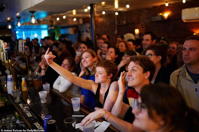 Into it: The audience at the tavern reacted as they watched the episode