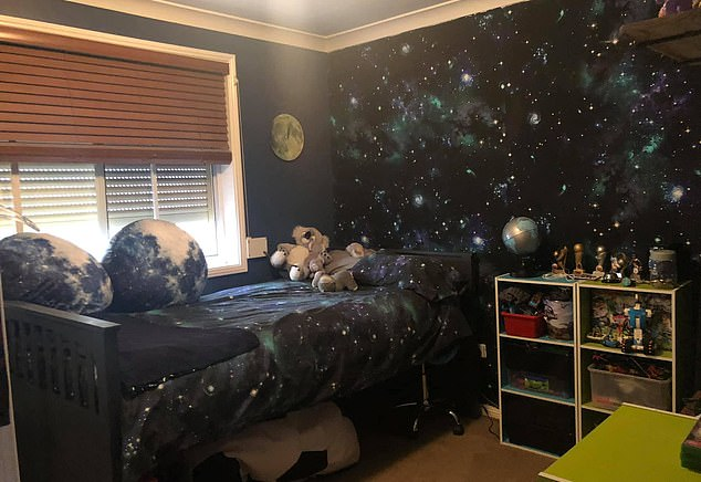 A savvy Australian mum has renovated her son's room and created a space-themed feature wall using $17 quilt cover from Kmart and liquid starch