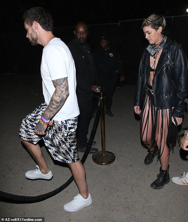 In good company:Shortly after sharing his latest post, Liam was seen making his way into a private area of the Coachella site with a female companion