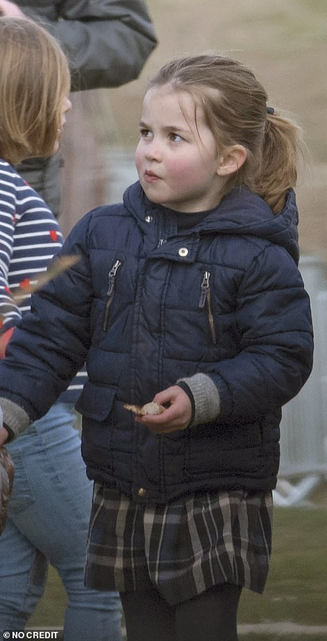 Princess Charlotte, known for her confident public displays, proved her own star factor in her Gingham designer dress, teamed with woolly tights and a quilted jacket as she enjoyed the day out