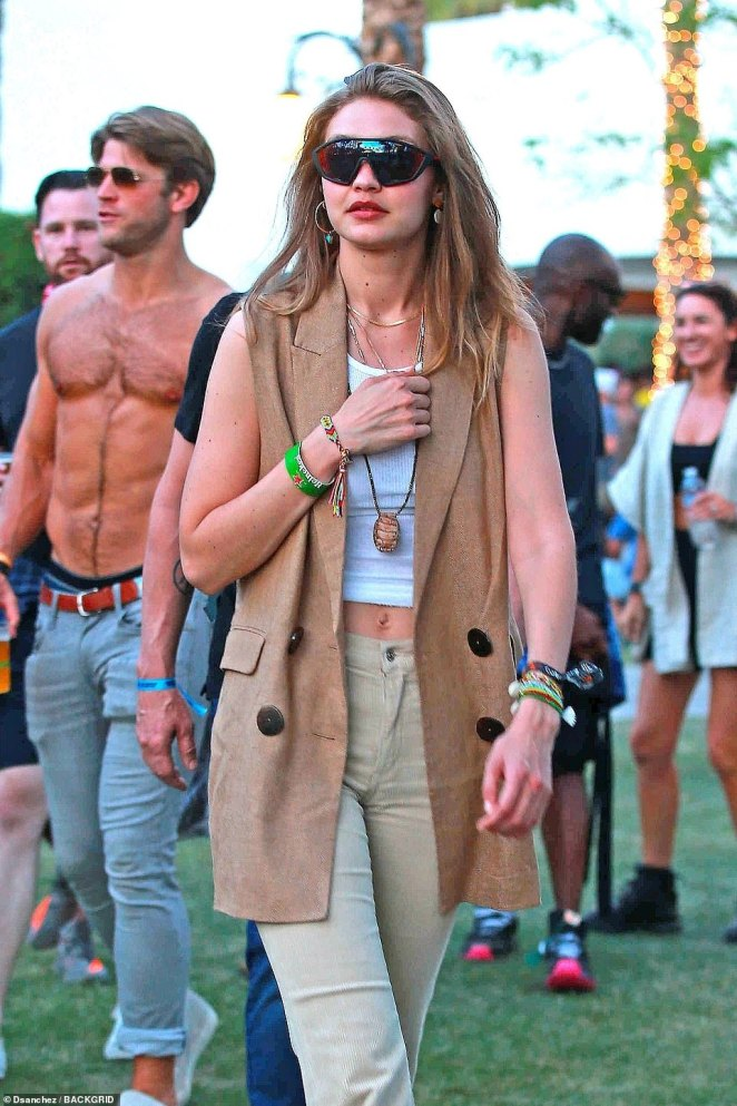 Hint of skin: Gigi flashed a glimpse of her toned stomach under her retro ensemble on Sunday