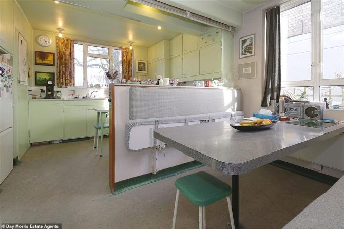 The house has clocks built in to its walls and the kitchen features a table with two folding benches to save space. All the original mid-century mint-green fittings are still in place