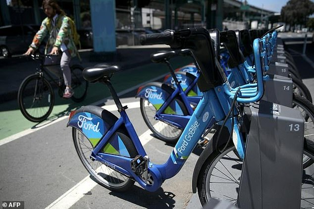 Lyft last year acquired Motivate, the operator of Ford GoBike (pictured). The firm soon expects to roll out new electric bikes to replace the old ones that can be accessed with a QR code